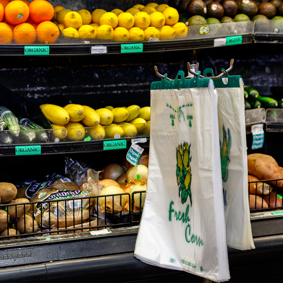 header bags in front of produce
